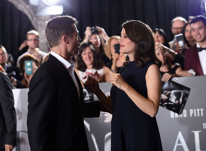 Marion Cotillard and Brad Pitt at the 'Allied' red carpet fan event held at the Regency Village theatre, Westwood, CA
