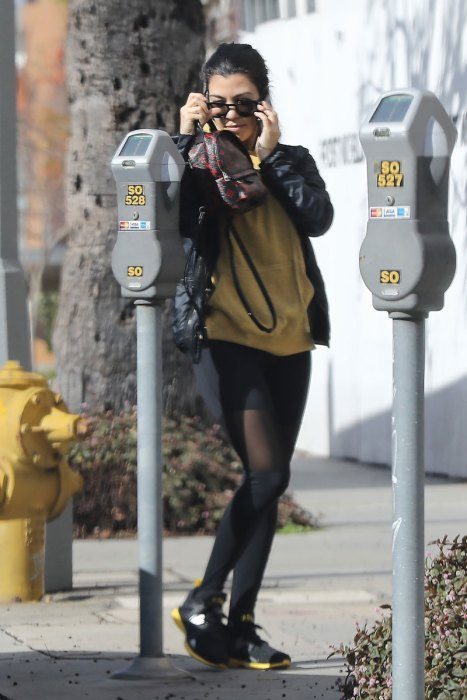 *EXCLUSIVE* Kourtney Kardashian hides her face as she heads to a laser hair removal spa
