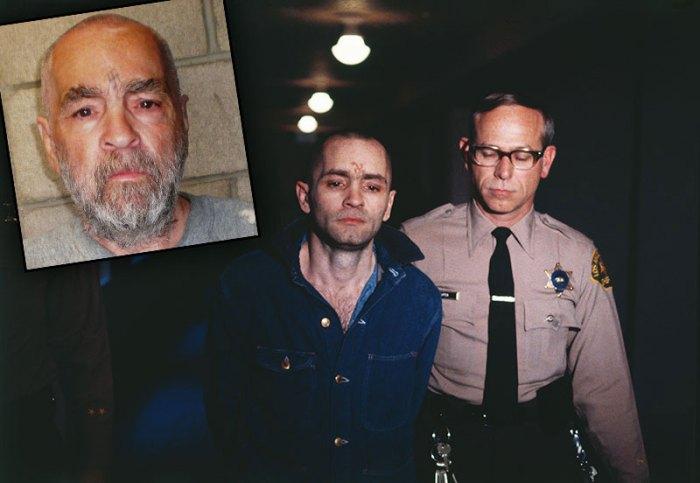 Policeman Escorting Charles Manson