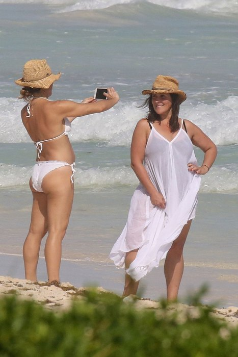 Ricki Lake cools off with a friend in the crisp waters of Cancun