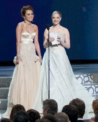 Presenters Miley Cyrus and Amanda Seyfried