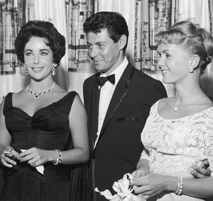 With husband #4, Eddie Fisher, whom she stole from pal Debbie Reynolds.