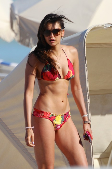 'The Vampire Diaries' star Nina Dobrev, 24, in a red flower print bikini in Miami Beach, FL.