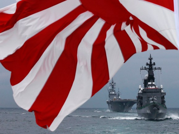Japanese Maritime Self-Defense Force destroyer Kurama leads destroyer Hyuga during a naval fleet review at Sagami Bay, off Yokosuka, south of Tokyo