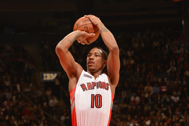 TORONTO, CANADA - NOVEMBER 13: DeMar DeRozan #10 of the Toronto Raptors shoots a free throw against the Chicago Bulls during the game on November 13, 2014 at the Air Canada Centre in Toronto, Ontario, Canada.  NOTE TO USER: User expressly acknowledges and agrees that, by downloading and or using this Photograph, user is consenting to the terms and conditions of the Getty Images License Agreement.  Mandatory Copyright Notice: Copyright 2014 NBAE (Photo by Ron Turenne/NBAE via Getty Images)