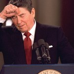 President Ronald Reagan knocks his head while responding to a reporter's question during a news conference at the White House March 19, 1987. Reagan said he never deliberatly lied to the public, although he admitted to a misstatment about Israeli involvement in the Iran-Contra affair. (AP Photo/Dennis Cook)