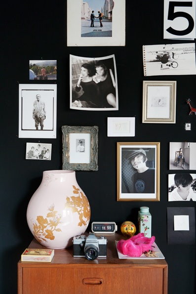 Black wall with photos