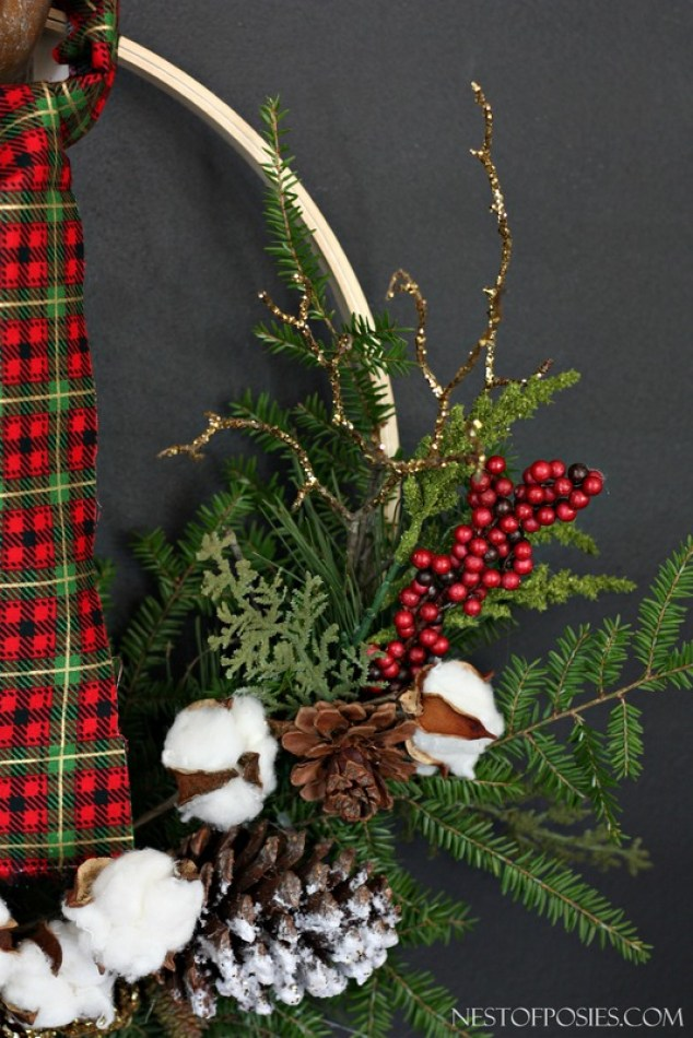 Glittered Branches and Tree trimmings help make up the LumberJack Plaid Wreath