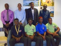 SKNIS Photo:  Francis, Chapman, Browne and Liburd  (seated left to right) were welcomed home by officials including (standing left to right) the Director of Sports, Anthony Wiltshire, SKNAAA President, Glen Jeffers, Deputy PM, Shawn Richards and National Olympic Committee head, Alphonso Bridgewater