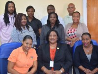SKNIS Photo:  Hilda Caley (front, seated) and the seven other members from the Turks and Caicos. Two officials (back row, second from left and right) from the St. Kitts and Nevis Inland Revenue Department are also shown.