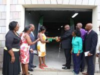 Verni Amory cuts the ribbon to officially open the new Social Security Building in Nevis. She is flanked by her husband Premier Amory (left) and Prime Minister of St. Kitts and Nevis, Dr.  the Hon. Timothy Harris.