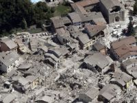Amatrice: Most of the pretty historic town is now rubble, blanketed in grey dust