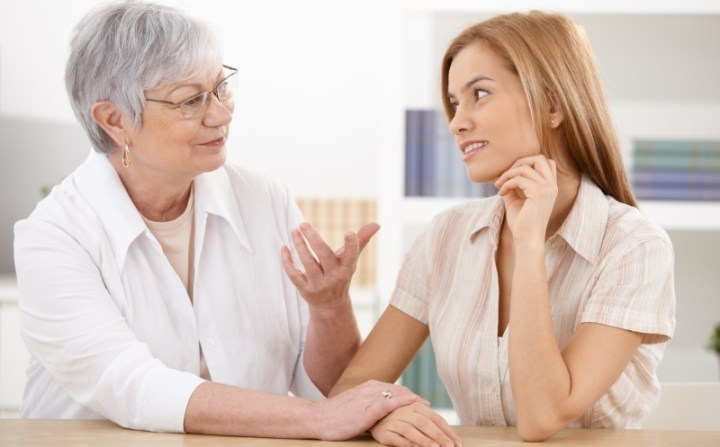 younger woman talking to an older woman