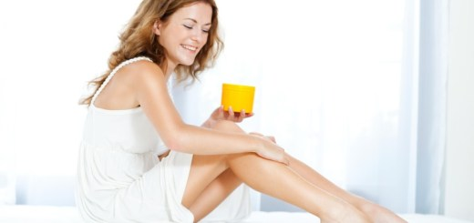 woman applying moisturizer to her legs_New_Love_Times