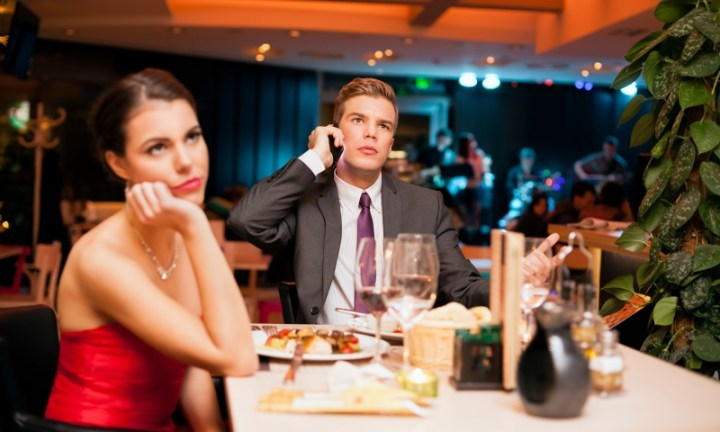 man talking on the phone while on a date_New_Love_Times
