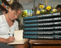 """KEY WEST, Fla. -- Lorian Hemingway, granddaughter of Ernest Hemingway, signs copies of her latest book, """"A World Turned Over,"""" at Key West Island Book Store, during the Hemingway Days festival. Lorian Hemingway also announced winners of her 22-"""