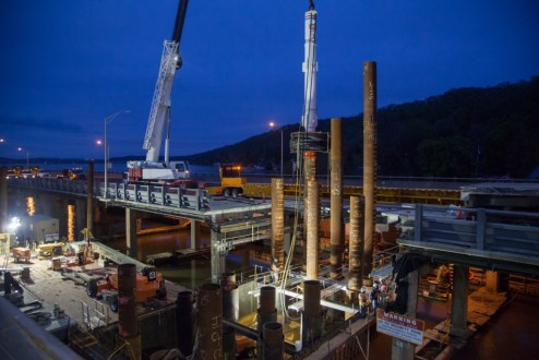 April 30, 2016 - Six 75-foot-tall foundation piles are installed under the Tappan Zee Bridge in an overnight operation.
