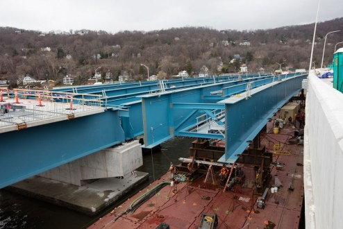 April 7, 2017 - A girder assembly is maneuvered between the eastbound and westbound bridges.