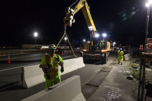August 26, 2017 - Workers set concrete barriers in preparation for westbound traffic on the new bridge.
