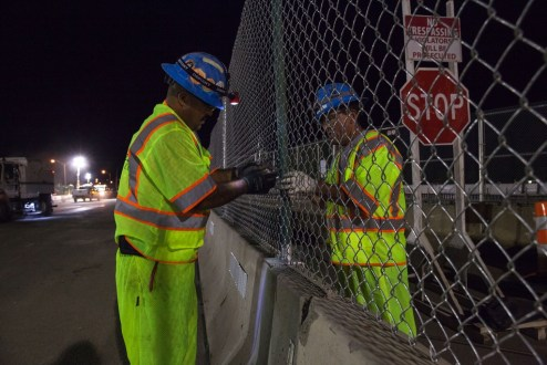 August 26, 2017 - Workers install fencing near the Westchester landing.
