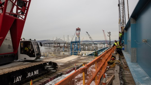 December 15, 2017 - A steel girder assembly is prepared at the Westchester landing. In the coming weeks, the assembly will be pushed along a track to reach the nearby concrete piers.