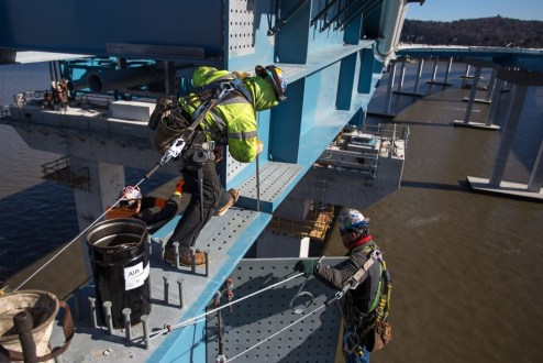 February 4, 2017 - Workers adjust the connection between a section of structural steel and the main span.