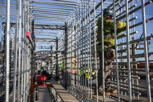 January 21, 2016 - Galvanized steel bars are tied with exact precision to create reinforcement cages for the main span.