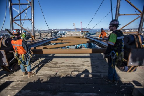 February 22, 2016 - Crew members remove equipment previously used to install steel girders at the Westchester landing.