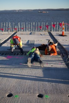 December 16, 2015 - Steel reinforcements are tied between the new road deck panels.