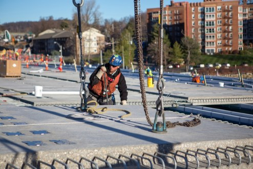 December 16, 2015 - A new road deck panel is installed with incredible precision.