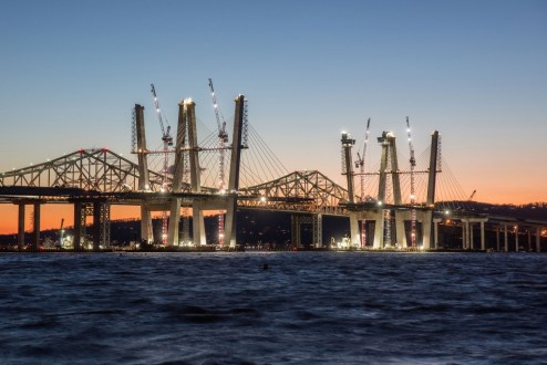January 4, 2017 - The main span is illuminated with temporary lighting as crews continue operations.
