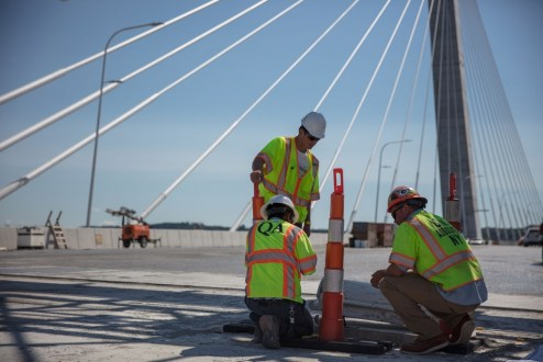 June 28, 2017 - Quality Assurance experts confirm the strength of the new bridge's roadway.