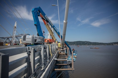 June 28, 2017 - Workers inspect the main span's stay cables.