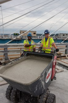 July 6, 2017 - Workers transport newly mixed concrete in large containers.