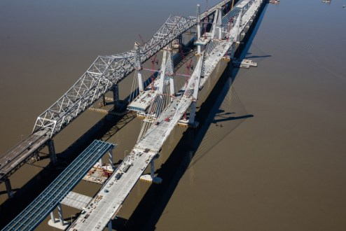 April 9, 2017 - Following the connection of the westbound bridge's roadway, work continues on the eastbound main span.