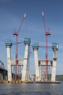 May 14, 2016 - The main span towers take shape with the assistance of blue jump forms and red tower cranes.