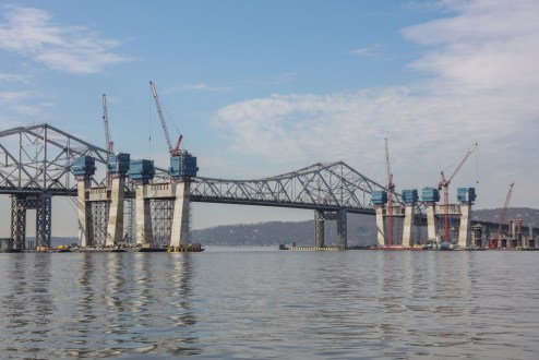 March 10, 2016 - The new bridge's main span is one step closer to completion with the installation of four concrete crossbeams.