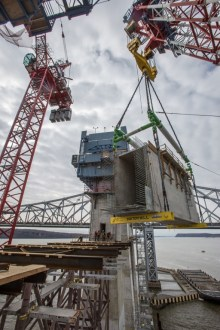 March 6, 2016 - I Lift NY places a concrete crossbeam atop temporary steelwork on the main span.
