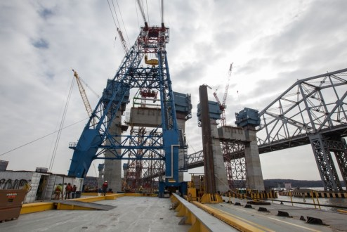 March 6, 2016 - The I Lift NY super crane uses anchors to adjust its position on the river.