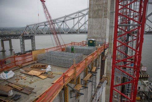 April 27, 2016 - Cages of reinforcing steel are prepared atop a main span tower crossbeam.