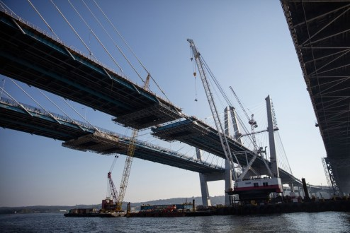 September 25, 2017 - The project team prepares to install the final section of structural steel on the main span.