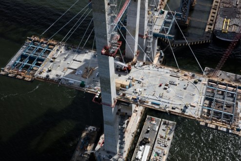 September 27, 2016 - Crews work atop the main span roadway.