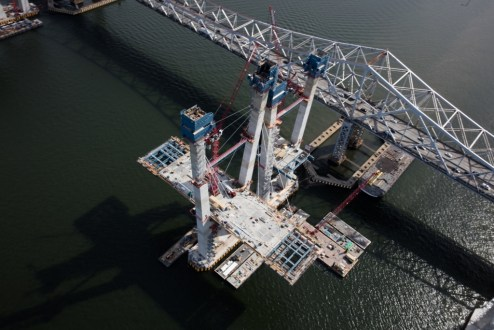 September 27, 2016 - Precast road deck panels rest atop the steel superstructure on the main span.