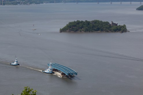 June 10, 2015 - The project's first steel girder assembly passes Bannerman's Island in Fishkill, NY.