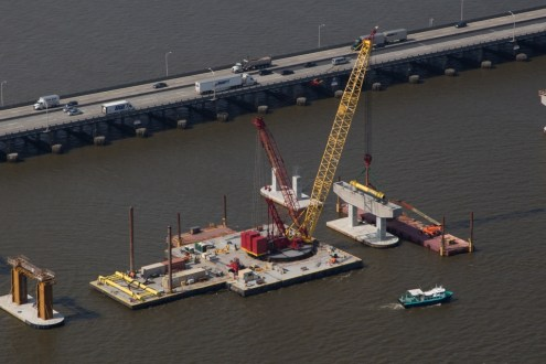 July 2015 - One of the project's cranes places a precast pier cap atop two approach span pier columns.