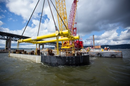 August 20, 2015 - Crews install the final approach span pile cap for phase one of construction.