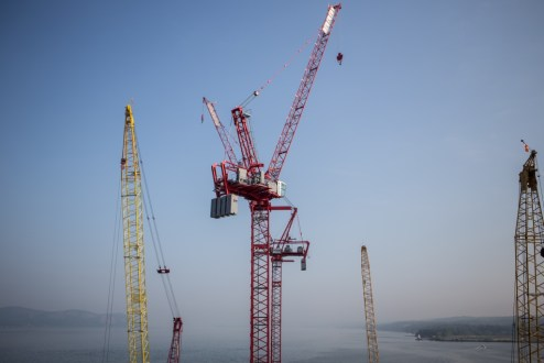 September 2, 2015 - Tower cranes will assist with the construction of the new bridge's iconic towers.