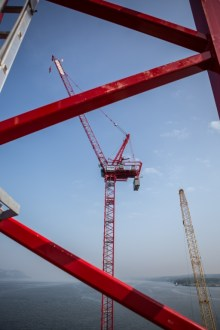 September 2, 2015 - Tower cranes will rise September 2, 2015 - 490 feet above the river to assist with the construction of the new bridge's  iconic towers.