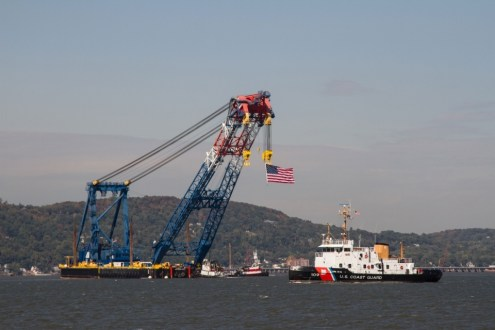 October 6, 2014 - Tugboats guide I Lift NY up the Hudson River under the watchful eyes of the U.S. Coast Guard, local and state police.