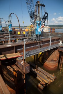 August 26, 2014 - A strand jack inside one of the project's main span pile caps during lowering operations.